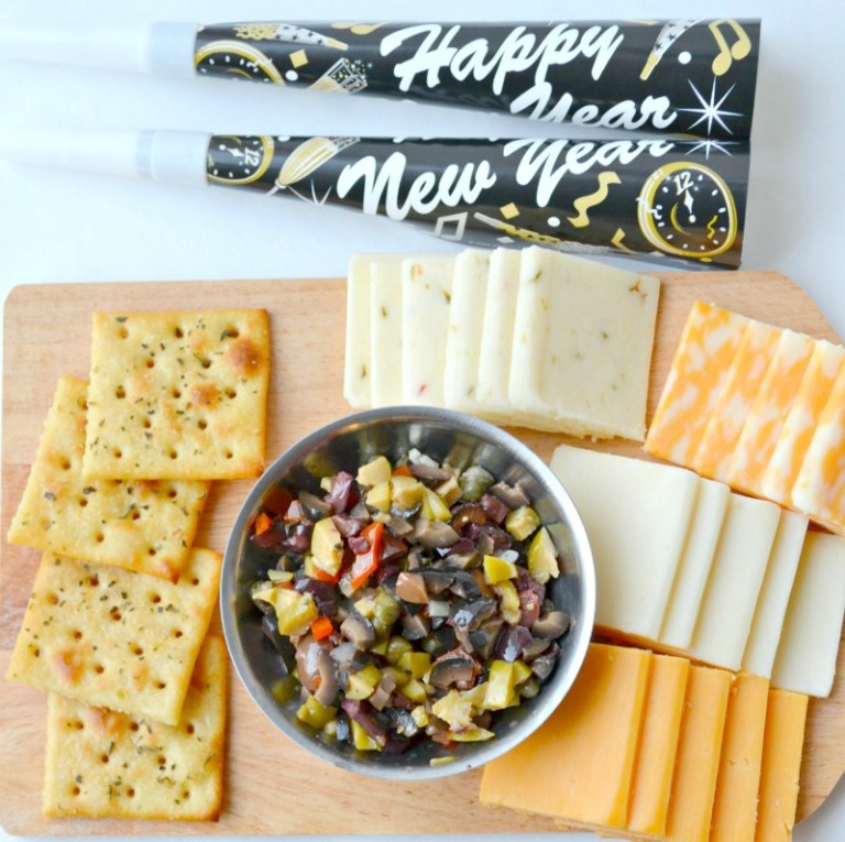 A Must Have New Year's Dish: Cheese, Tapenade & Seasoned Buttery Crackers